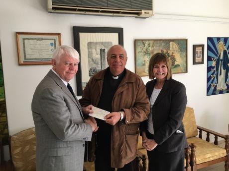 2016-1-7 Phillips presenting check to Father Kildani